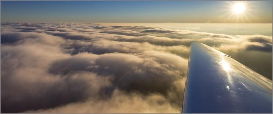 Cloud cover above Winterberg, right wing of airplane, sunset, blue sky, Winterberg, Hochsauerland district, Sauerland, North Rhine-Westphalia, Germany, Europe